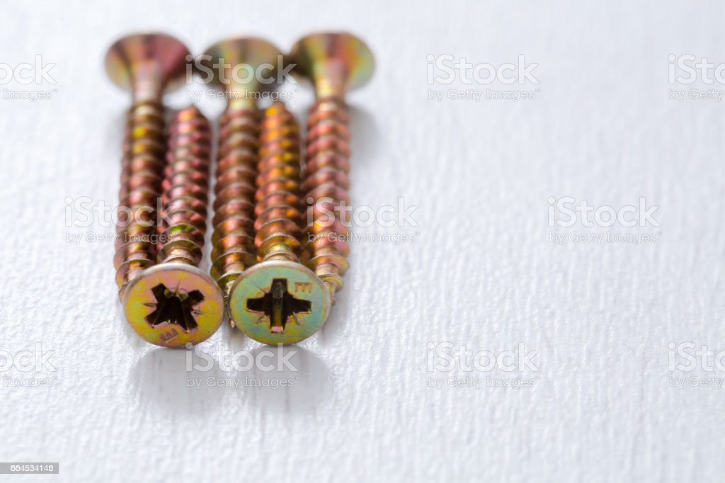 Self-tapping screws on a light background. royalty-free stock photo