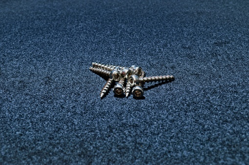 self-tapping screws with a hexagon cap on a black background