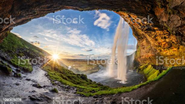 Photo of Seljalandfoss waterfall in summer time at sunset,  Iceland