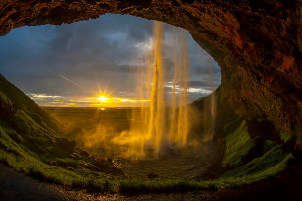 Seljalandsfoss waterfall against the backdrop of a bright sunset. Iceland stock photo