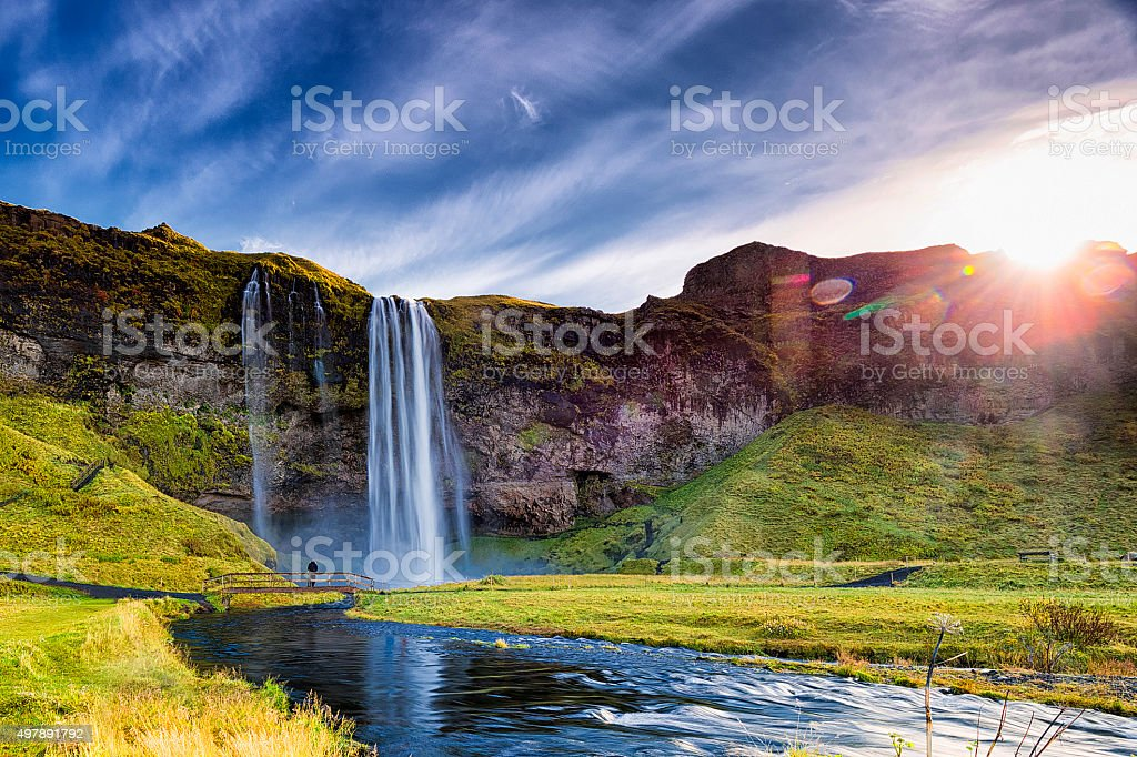 Seljalandsfoss Waterfall Against the Sun, South Iceland stock photo