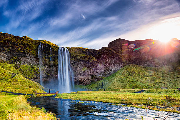 seljalandsfoss waterfall against the sun, south iceland - waterfall stock photos and pictures
