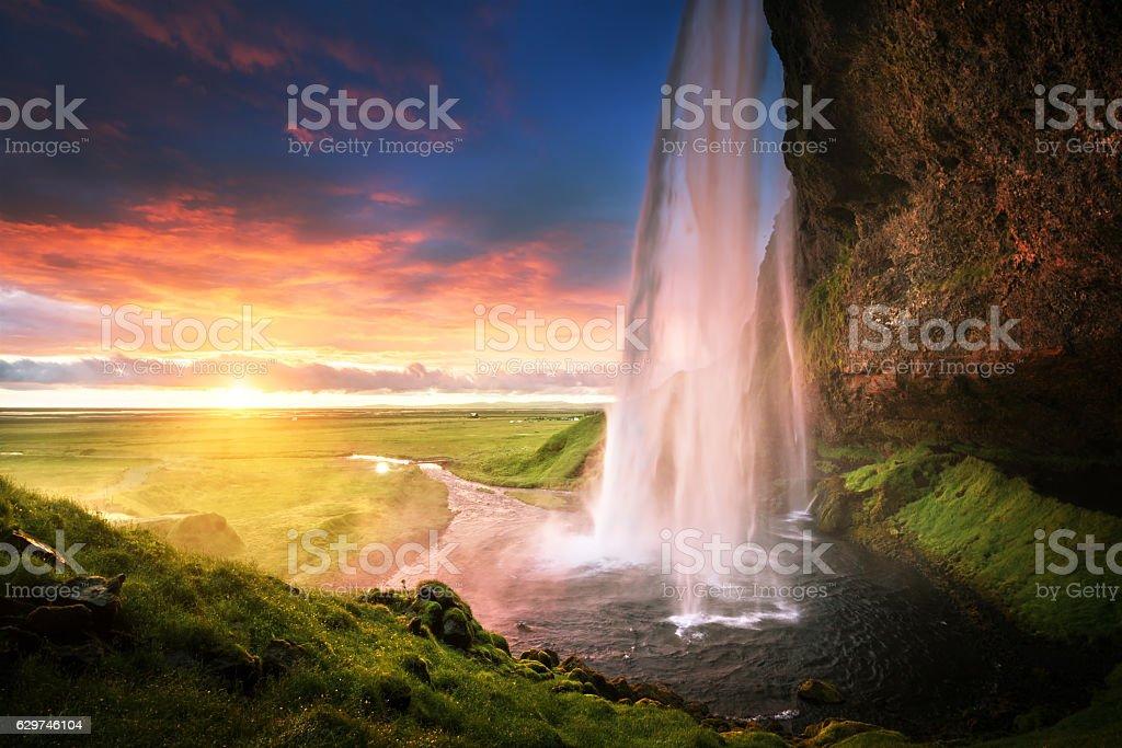 Seljalandsfoss waterfall at sunset, Iceland stock photo