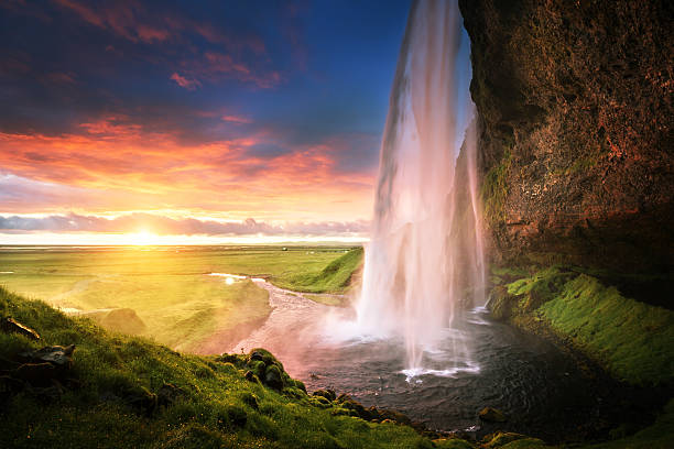 seljalandsfoss waterfall at sunset, iceland - waterfall stock photos and pictures