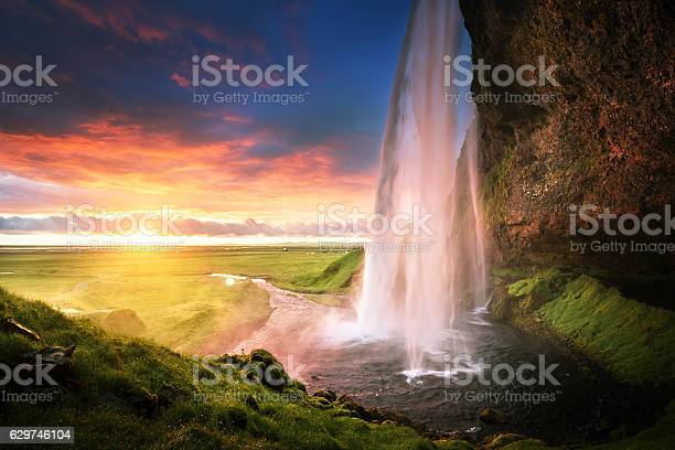 Photo of Seljalandsfoss waterfall at sunset, Iceland
