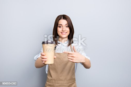 istock Sell snack order blank empty place for text sale discount you look fresh forefinger people person concept. Portrait of beautiful girl with bob hairdo holding big cup with cap isolated gray background 956554262