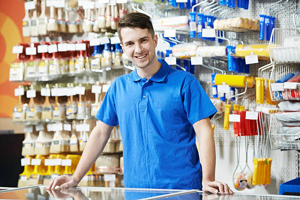 Seller at home improvement store Happy seller assistant man in DIY hardware or home improvement store assistant stock pictures, royalty-free photos & images