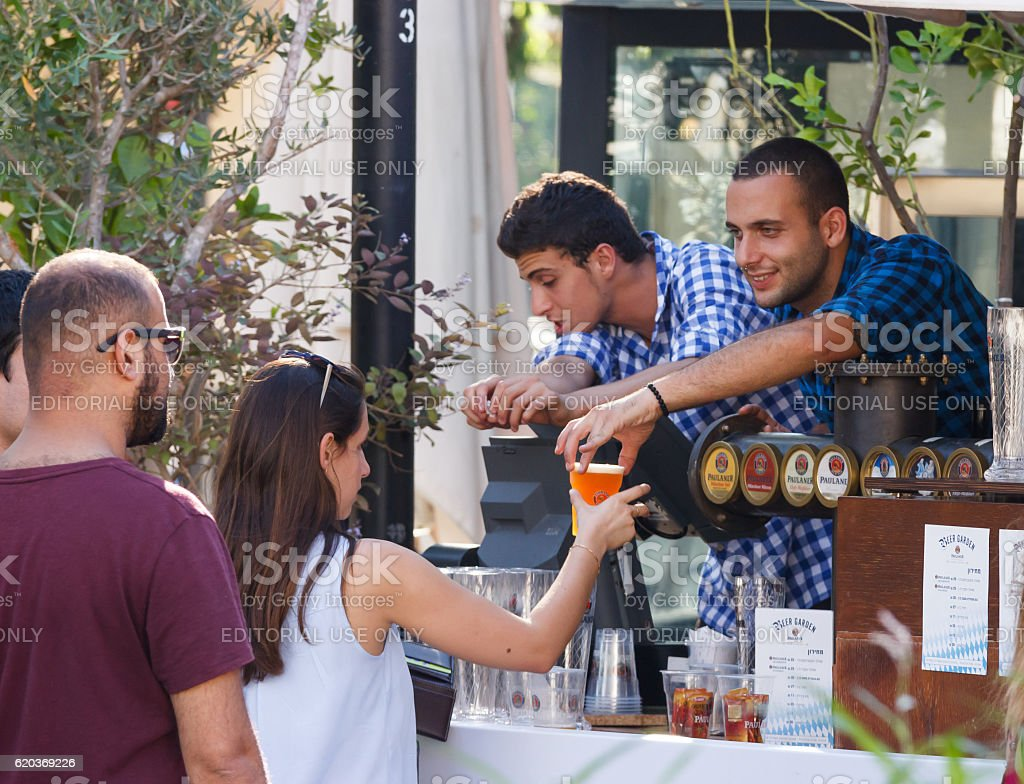 Seller communicates with guest of festival at annual beer festiv stock photo