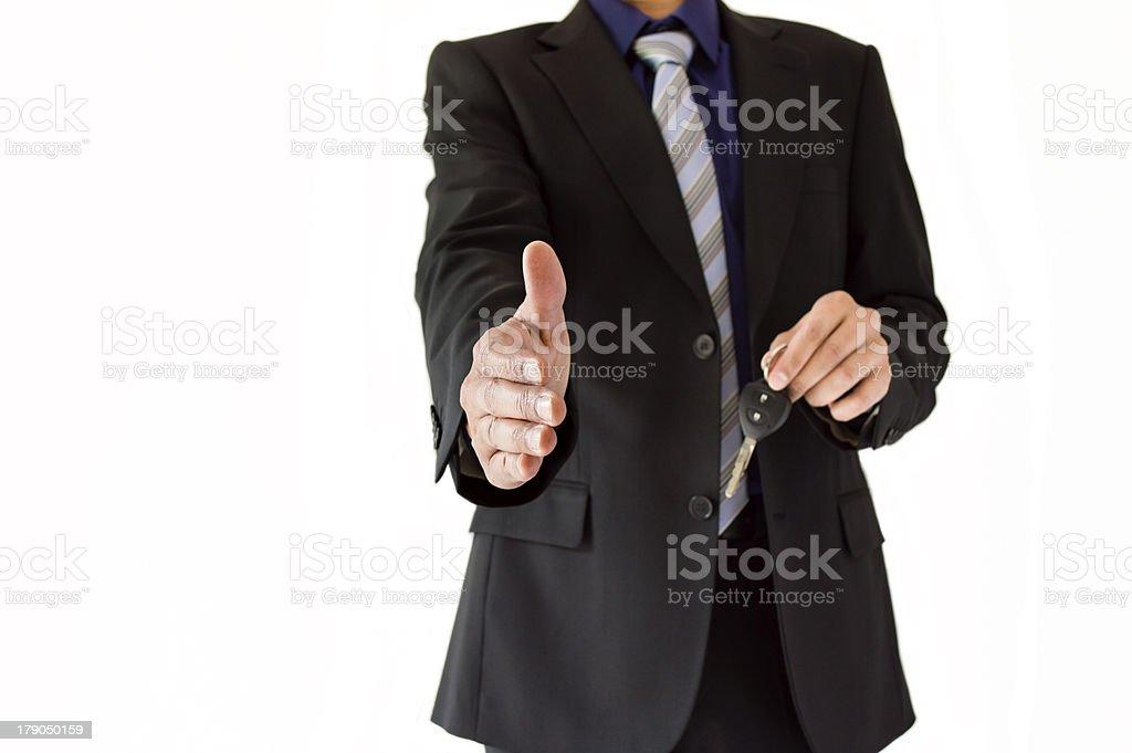 seller giving a handshake royalty-free stock photo