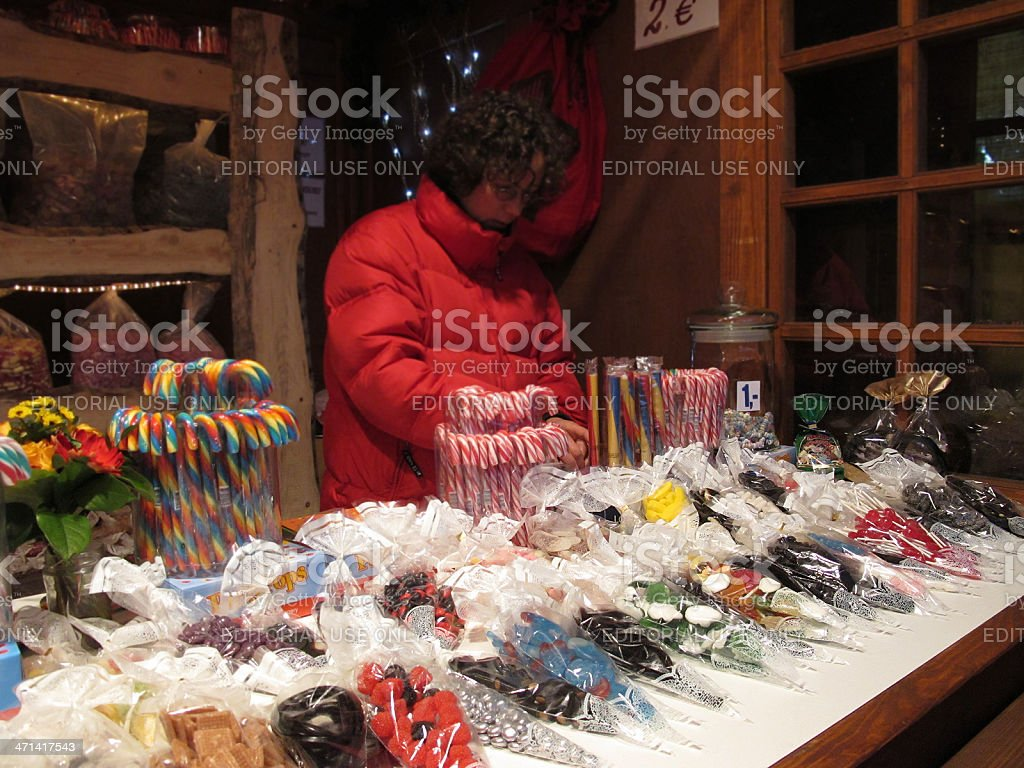 Seller in Candies stand at Christmas Markt Berlin (Germany) royalty-free stock photo