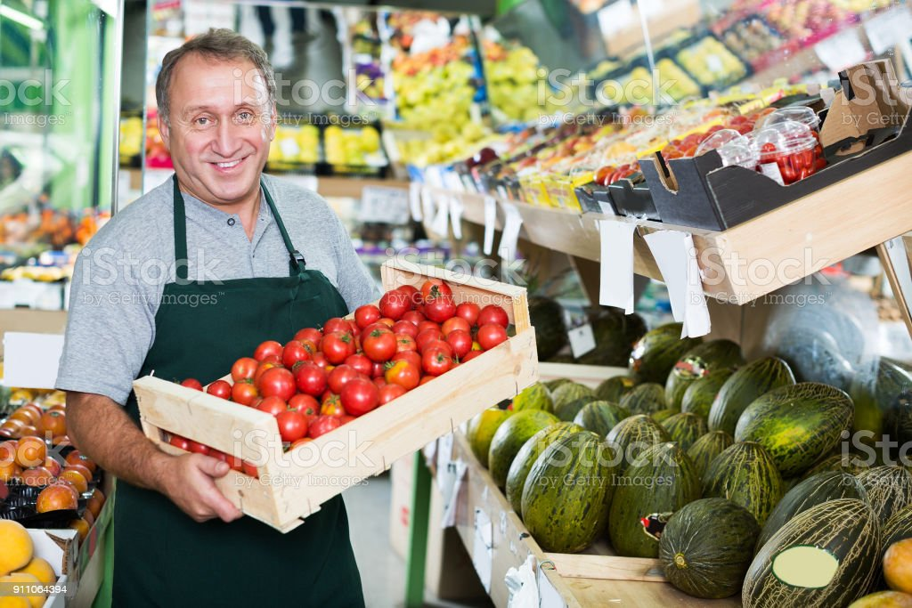 Seller is offering red tomatos stock photo