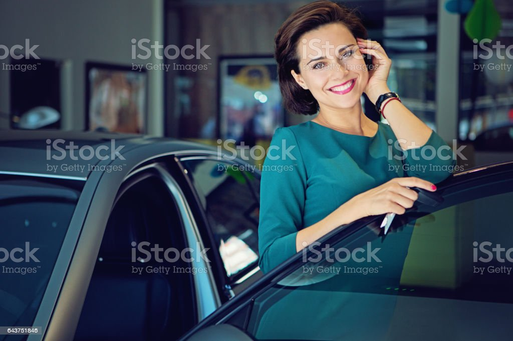 Seller is presenting a new car to a customer stock photo