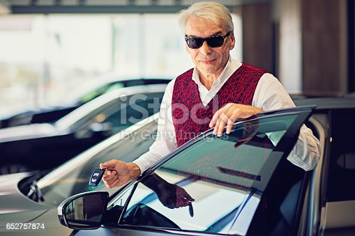 1138561232 istock photo Seller is presenting a new car to a customer 652757874