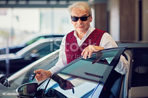 1138561232 istock photo Seller is presenting a new car to a customer 924804846