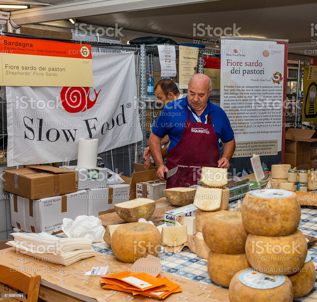 Seller of sheep milk cheese ('Terra Madre Salone del Gusto') stock photo