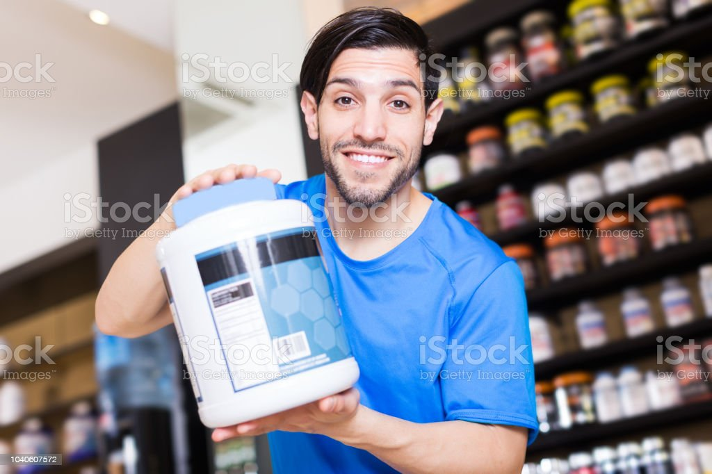 seller showing different sport nutrition stock photo