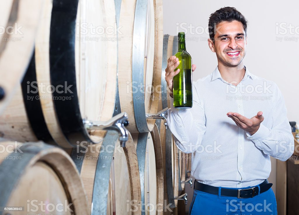 seller standing with bottle stock photo