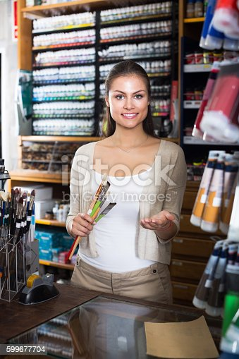 594918592 istock photo Seller to help at cash desk 599677704