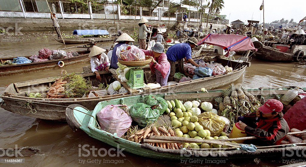 Sellers in a floating market royalty-free stock photo