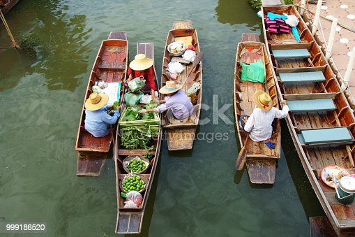 sellers making trading in floating market for tourist