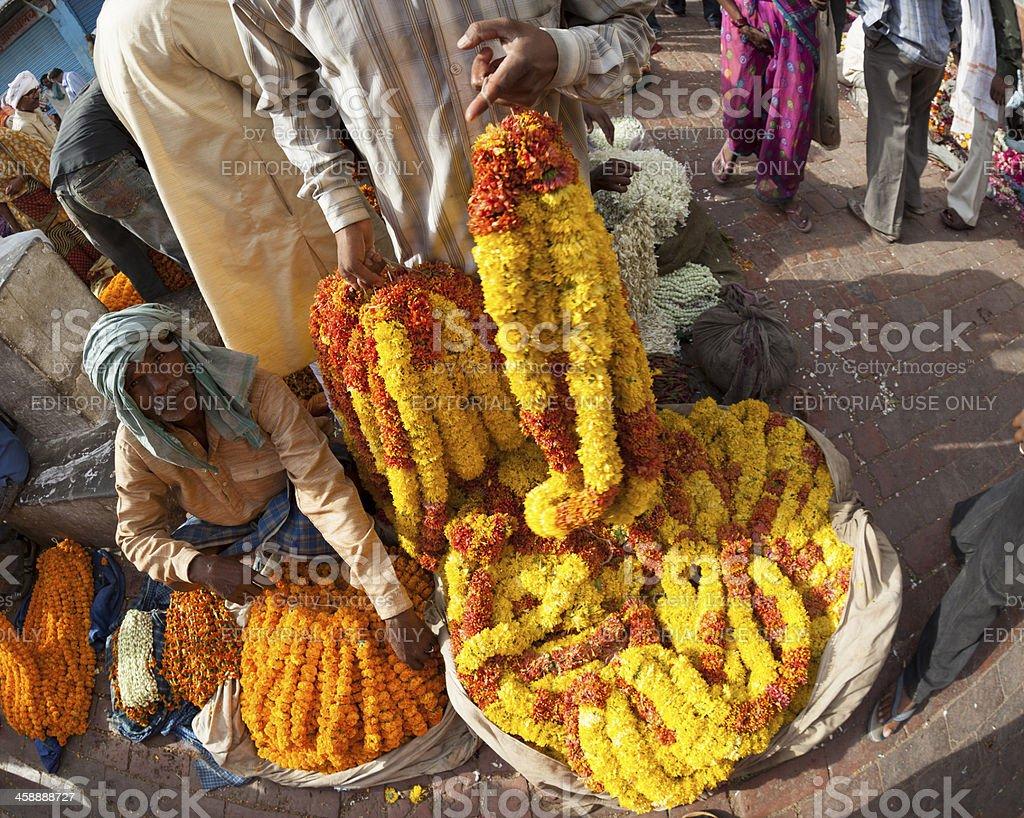 Sellers of puuja flowers in market,Varanasi,India royalty-free stock photo