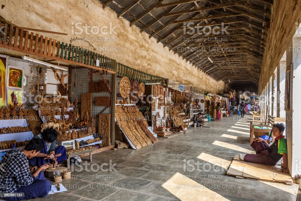 Sellers offering souvenirs at the entry of Shwezigon Pagoda in Myanmar stock photo