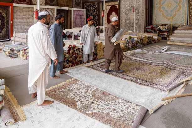 Sellers show exquisite carpets in the store in Masafi Friday market on Dubai-Fujairah road stock photo