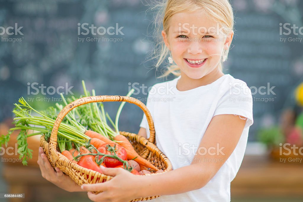 Selling a Basket of Produce stock photo
