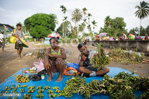 A man and woman sell betel nut and lime sticks at the market in Vanimo, Papua New Guinea (2017). Betel nut -- called