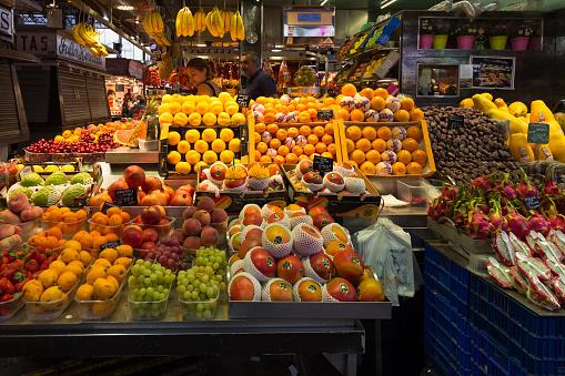 Selling fresh fruits on the famous market La Boqueria in Barcelona.