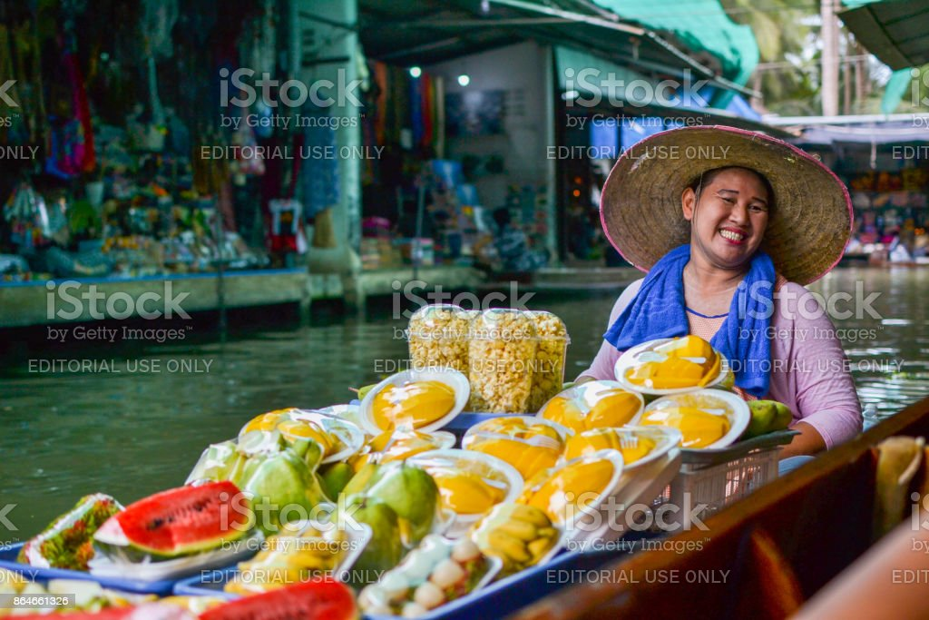 Selling her fruits with a smile stock photo