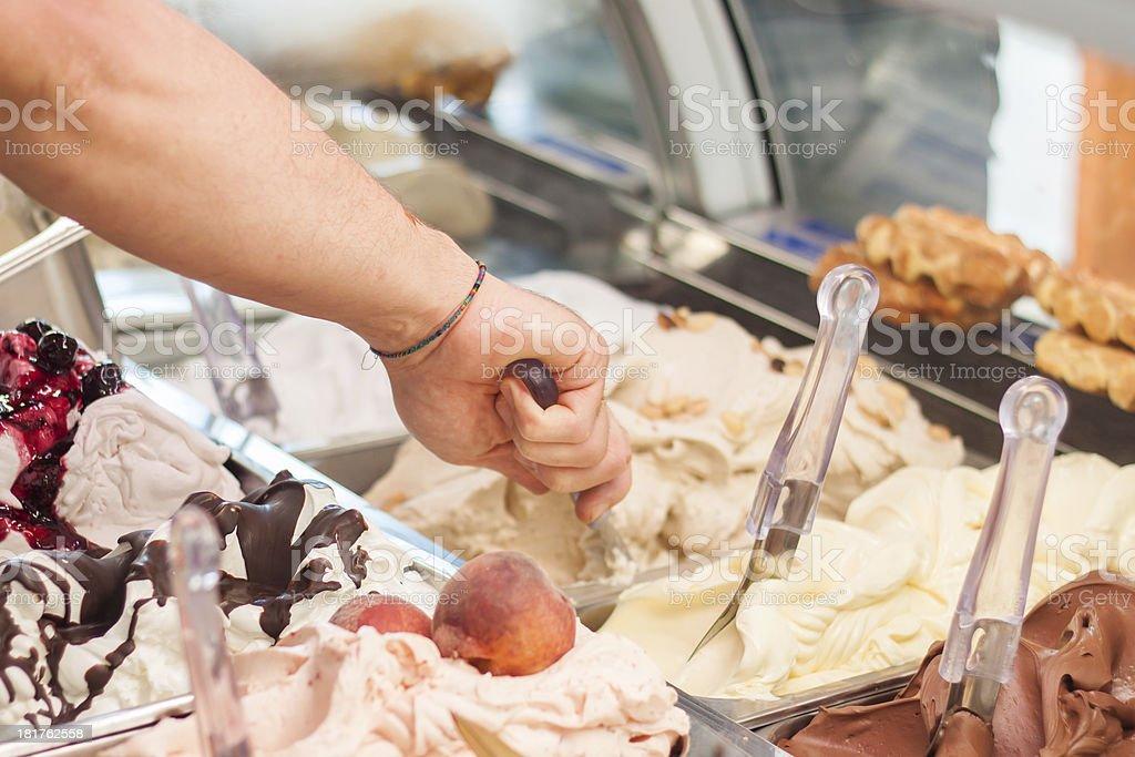 Selling ice-cream in gelateria stock photo