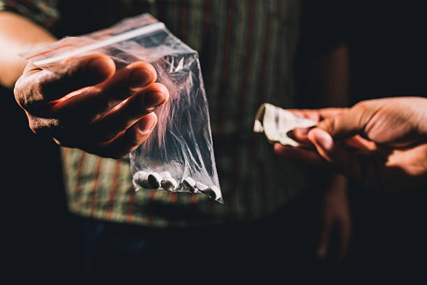 selling illegal pills - narcotic stock pictures, royalty-free photos & images