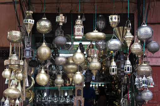 994119256 istock photo Selling lamps on the souk in Marrakech Morocco. 1221649768
