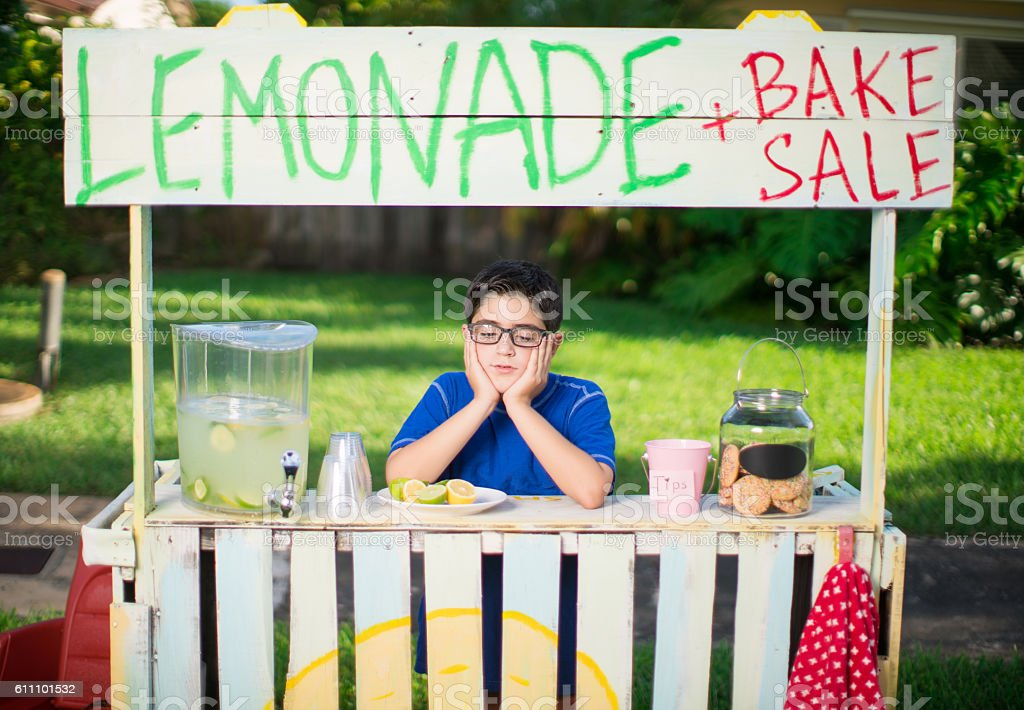 Selling lemonade and waiting for clients stock photo