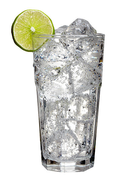 Seltzer Tall glass of Seltzer with a slice of lime isolated on a white background.  Professionally shot, color corrected, exported 16 bit and retouched for maximum image quality, larger files include path. tonic water stock pictures, royalty-free photos & images