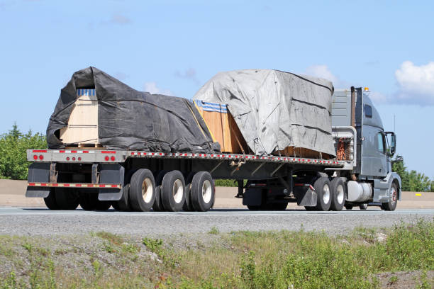 Semi Flatbed Truck On Highway stock photo