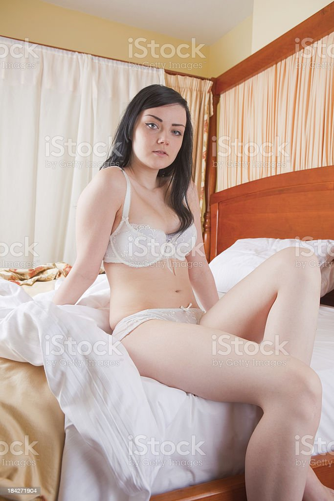Semi Nude Girl On A Four Poster Bed royalty-free stock photo
