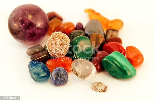 istock Semi precious stones / Crystal Stone Types / healing stones, worry stones, palm stones, ponder stones / Various stones gemstones background texture / Heap of various colored gems mineral collection. 906786024