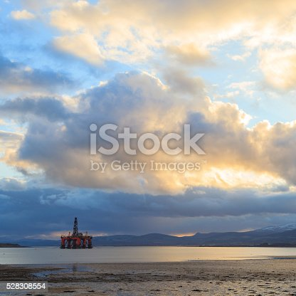 istock Semi Submersible Oil Rig at Cromarty Firth during Sunset 528308554