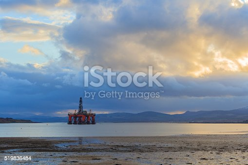 istock Semi Submersible Oil Rig at Cromarty Firth during Sunset Time 519836484