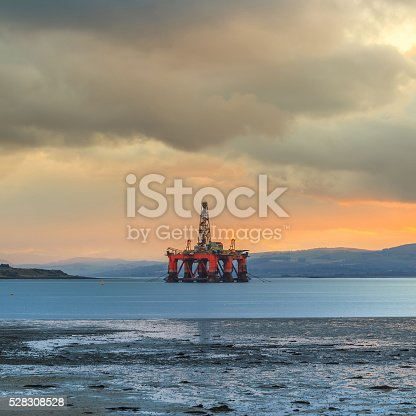 istock Semi Submersible Oil Rig at Cromarty Firth during Sunset Time 528308528