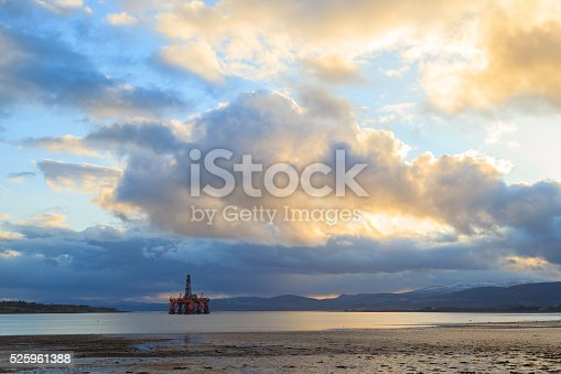 istock Semi Submersible Oil Rig at Cromarty Firth Sunset Time 525961388