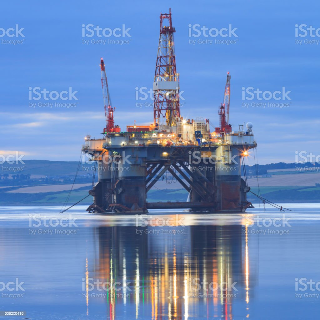 Semi Submersible Oil Rig during Sunrise at Cromarty Firth stock photo