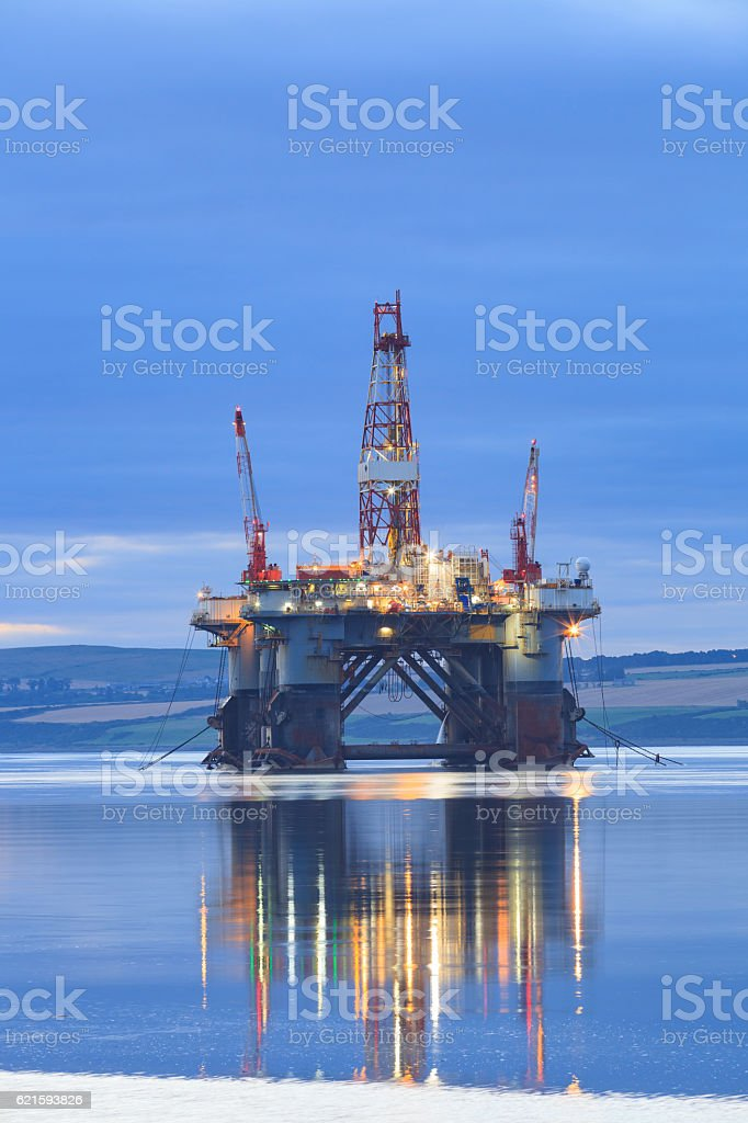 Semi Submersible Oil Rig during Sunrise stock photo
