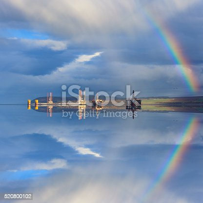 istock Semi Submersible Oil Rigs and Rainbow with Reflection 520800102