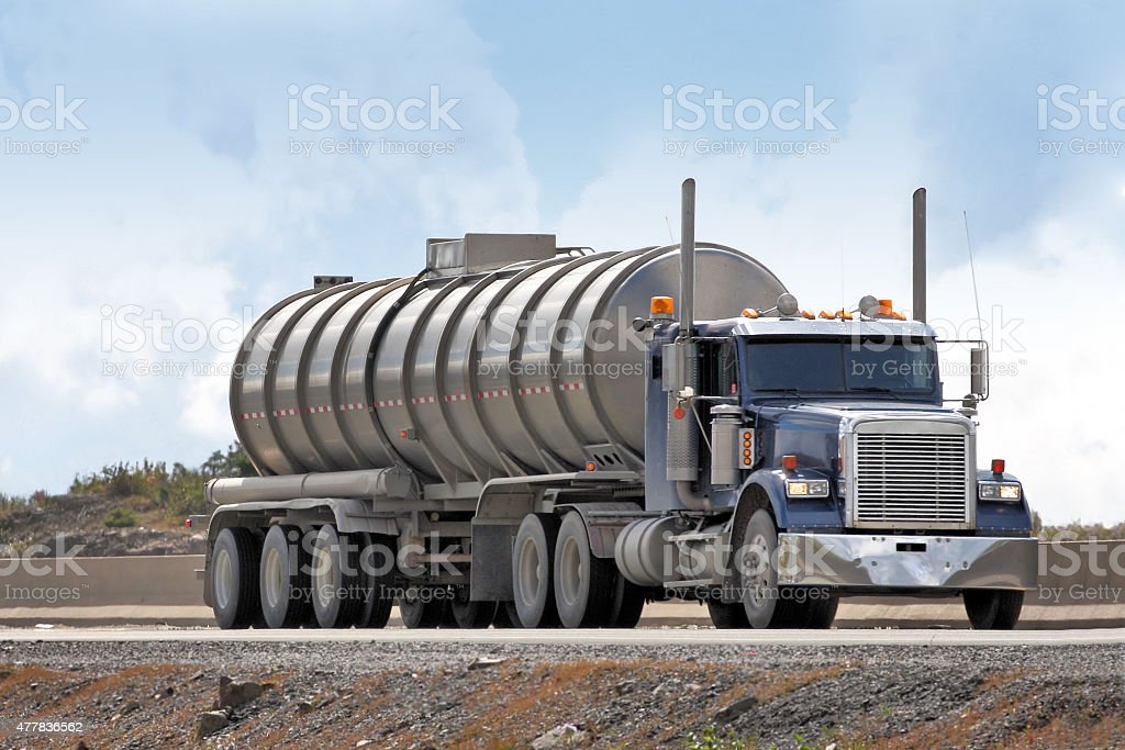 Semi Tanker Truck Hauling Industrial Waste To A Treatment Facility stock photo