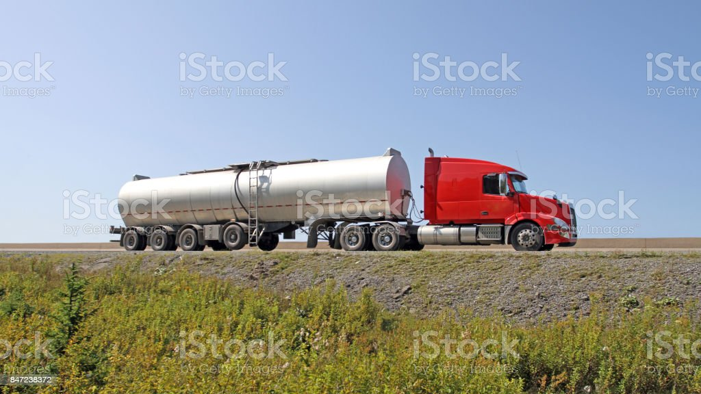 Semi Tanker Truck Travelling On Highway, 16x9 Format stock photo