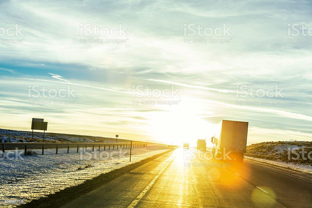 Semi Trailer Trucks on Western Sunset USA Expressway stock photo