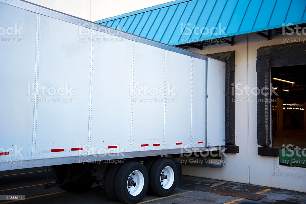 Semi trailer unloading cargo in dock warehouse with door open royalty-free stock photo & Semi Trailer Unloading Cargo In Dock Warehouse With Door Open ...